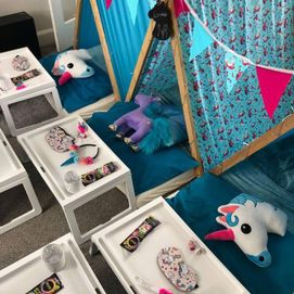 pink unicorn tents and bunting
