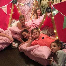 friends enjoying a pink flowers sleepover party