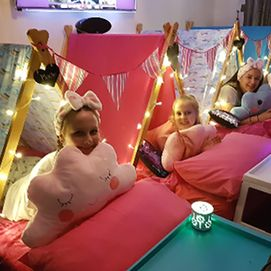 children enjoying a rainbow sleepover party